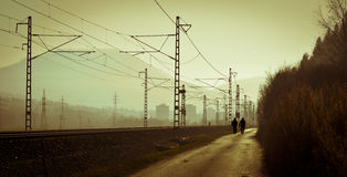Urban silhouette life. Silhouette shot of two men and a railroad Royalty Free Stock Images