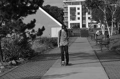 Urban skater. Urban skateboarder searching for pokemons stock images