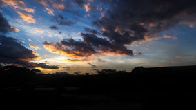 Urban sky blue and orange. Urban sky in its sunset with blue and orange colors, many clouds Stock Photo