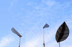 Urban sky monument and iron leaves Royalty Free Stock Photography