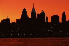 Urban skyline. Silhouetted by sunset Stock Photos