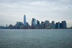 Urban skyline across water Stock Photography