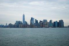 Urban skyline across water Stock Photography