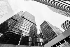 Urban skyline with skyscrapers, black and white. Urban skyline with business skyscrapers, high-rise office buildings in city of Hong Kong. Black and white photo Royalty Free Stock Image