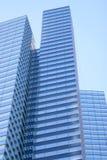 Urban skyscraper. Tall urban skyscraper with glass facade Stock Photos
