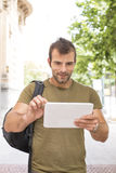 Urban smiling man laptop with tablet computer in the street. Stock Image