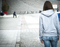 Urban solitude abuse girl. Lonely girl in the city in danger Royalty Free Stock Photo
