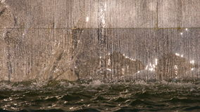 Urban Sparkling Waterfall. Water gracefully flowing down from the stage of the granite city fountain cascade stock video