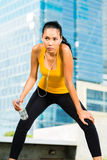Urban sports - fitness in Asian or Indonesian city. Urban sports - Asian Indonesian woman doing fitness in the city on a beautiful summer day Royalty Free Stock Image