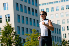 Urban sports - fitness in the city. On a beautiful summer day Stock Photography