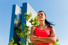 Urban sports - fitness in the city. On a beautiful summer day Stock Photos