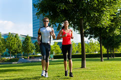 Urban sports - fitness in the city. Urban sports - couple jogging for fitness in the city on a beautiful summer day Royalty Free Stock Photography