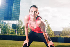 Urban sports - running fitness in the city. Urban sports - woman running for fitness in the city on beautiful summer day Stock Photos