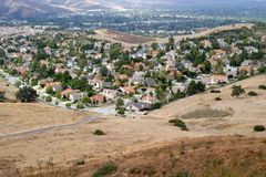 Urban Sprawl. Communities of families spreading into the foothills of the countryside stock images