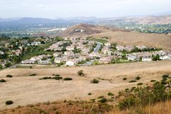Urban Sprawl. Communities of families spreading into the foothills of the countryside stock image