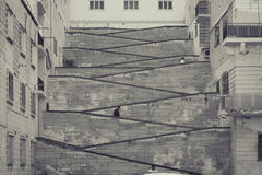 Urban stairs between buildings, two levels streets, three cities Royalty Free Stock Images