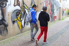 Teenagers and an urban graffiti wall,Friesland,NL Stock Photos