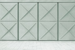 Urban street background. Metallic textured wall and grey tiled floor. Copy space Stock Photos