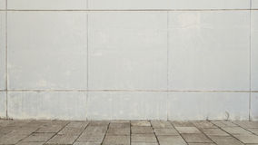 Urban street background. White wall and grey tiled floor. Stock Photos