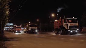 Urban street cleaning sweepers at night stock footage
