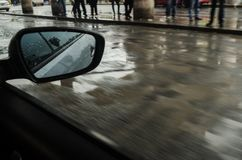 Urban street from inside a moving car, rainy day in a city, people on the sidewalk on a rainy day stock photos