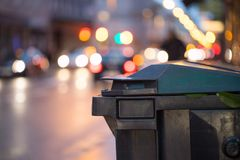 Garbage cans and street lights in urban city, evening. Urban street life with garbage container and street lights can rubbish waste plastic recycling city stock photography