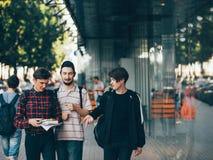 Urban street lifestyle bffs teenage education. Urban teenage hipster lifestyle. young boys choose future career preparing to enter university or college. bffs stock photo