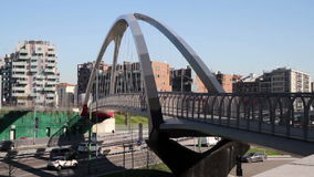 Urban street with modern suspension footbridge. And vehicle traffic stock video