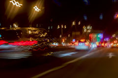 Urban street night traffic with bokeh lights. Blurred auto with bright brake lights, city street lights and speed Stock Photo