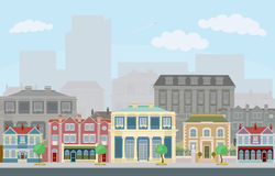 Urban street scene with smart townhouses. An urban street scene with smart townhouses and skyscrapers in the background royalty free illustration