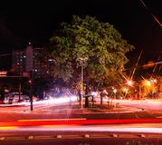 Colorful long exposure photo of cars on a two-ways large avenue,. Urban street traffic at night. Colorful long exposure photo of cars on a two-ways large avenue Royalty Free Stock Photography