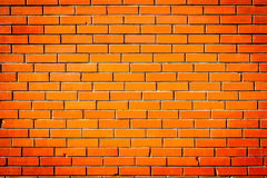 Urban street wall background. Vibrant orange exterior building brick wall background Royalty Free Stock Image