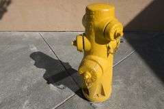 Yellow city fire hydrant, water pressure royalty free stock photography