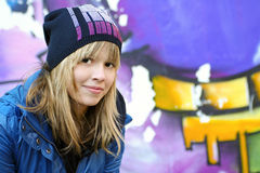 Urban style. Girl teen on the streets of a modern city royalty free stock images