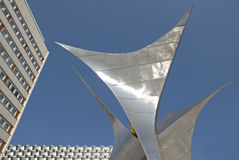 Urban style. Modern metal sculpture in the middle of town Royalty Free Stock Images