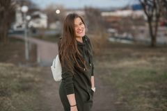 Urban style and fashion concept. Outdoor portrait of beautiful stylish young European female model with long brown hair. Wearing trendy hoodie and white Stock Photos