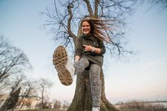 Urban style and fashion concept. Outdoor portrait of beautiful stylish young European female model with long brown hair. Wearing trendy hoodie and white Stock Photography