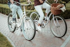 Close up of active people that riding bicycles royalty free stock photos