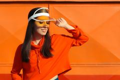 Urban Summer Fashion Girl with Sporty Hoodie and Clear Cap stock images