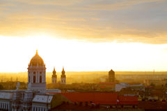 Urban sunset. Old architecture of Arad Catholic Cathedral, Romania Royalty Free Stock Photos