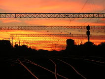 Urban sunset. Sunset close to railway station royalty free stock image