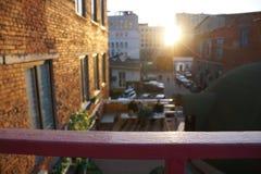 Urban sunset. Balcony view. Aged break wall. Street of city. stock image