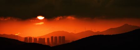 Urban sunset. Beautiful city under the setting sun Royalty Free Stock Photography