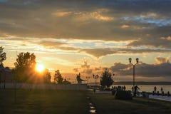 Urban sunset on city lake quay Royalty Free Stock Photography