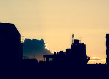 Urban Sunset in Tokyo. Silhouette of an urban city scene against a golden sunset Royalty Free Stock Photo