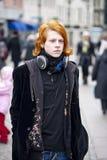 Urban teen boy. Teen boy walking in the street Royalty Free Stock Photography