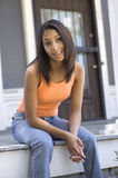 Urban teen on porch stock image