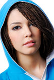 Urban teenage girl. Attractive young teen urban girl dressed in the blue hood Stock Image