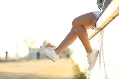 Urban teenager legs wearing sneakers Royalty Free Stock Images