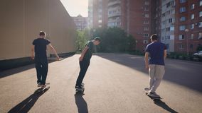 Urban teenagers enjoying outdoors skating together. Young healthy people spending time in skateboarding park jumping and. Group of urban teenagers are enjoying stock video footage